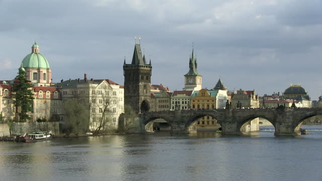 ws people on bridge over vltava river with city  / prague, hlavni mesto praha, czech republic - river vltava stock videos & royalty-free footage