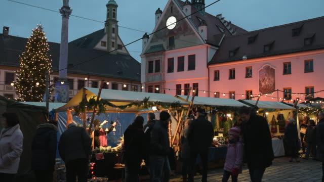 People on Christmas market in the evening