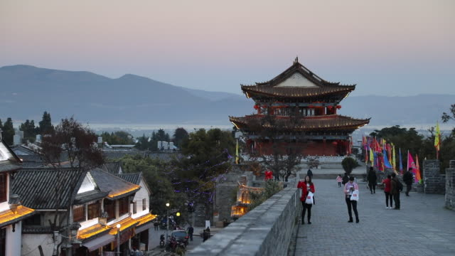 people on city walls, dali, yunnan, china, asia - temple building stock videos and b-roll footage
