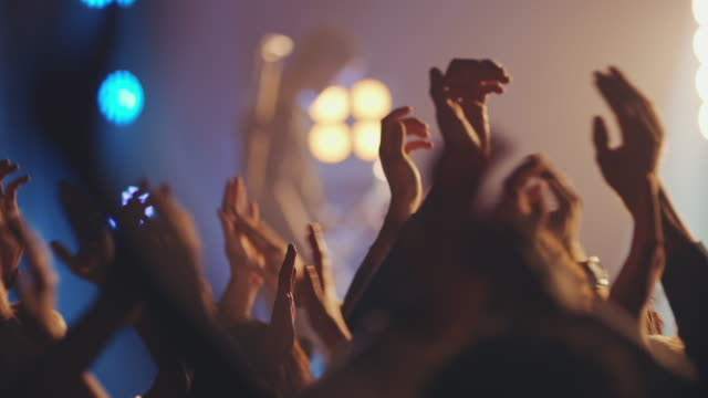 people on concert waving and clapping hands - nightlife stock videos & royalty-free footage