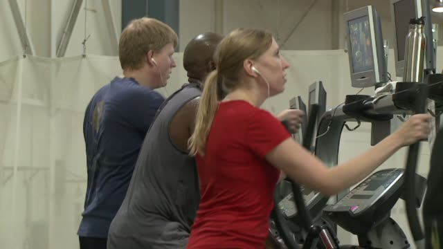 stockvideo's en b-roll-footage met people on elliptical machine at national institute for fitness and sport on october 06 2013 in indianapolis indiana - ellips