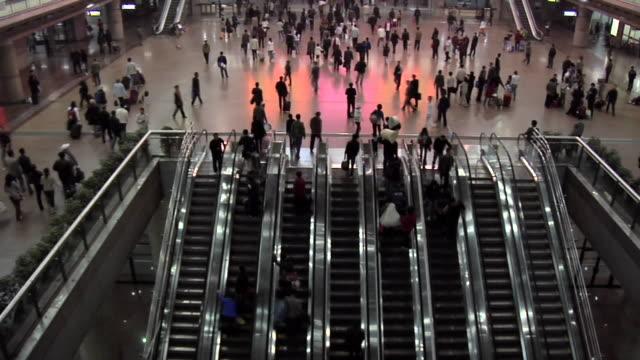 HA WS People on escalators at Beijing West Railway Station/ Beijing, China