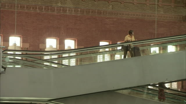 ms people on escalators in madrid train station / madrid, spain - railroad station stock videos & royalty-free footage