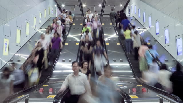 T/L People on escalators, in MTR underground station, Hong Kong