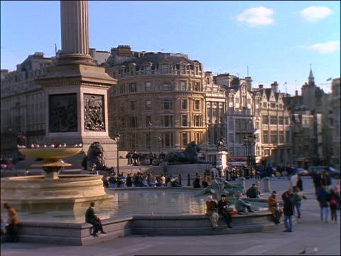 people on front of fountain in trafalgar square / london - 1997 stock videos and b-roll footage