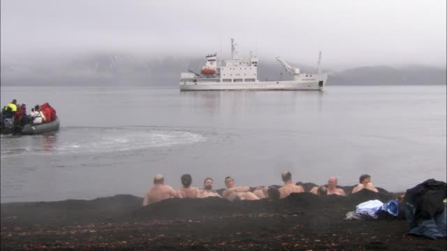 MS, People on geothermal beach, Deception Island, Antarctica