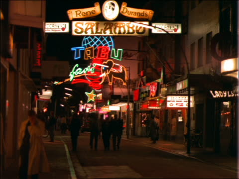 stockvideo's en b-roll-footage met people on hamburg street at night / neon signs - 1992