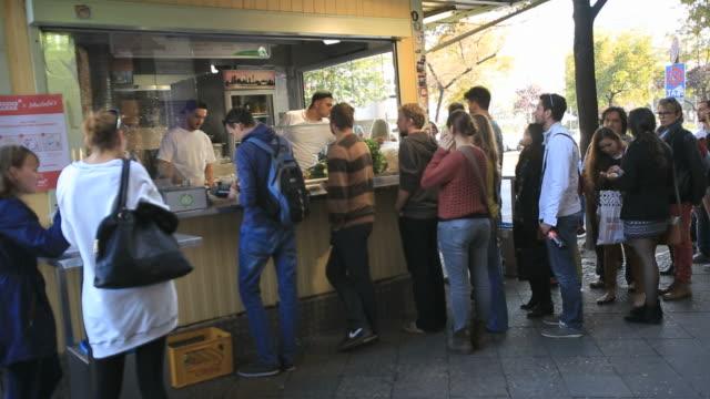 people on kew to mustafa's gemã¼se kebap, fast food in berlin-mehringdamm street - germany stock videos & royalty-free footage