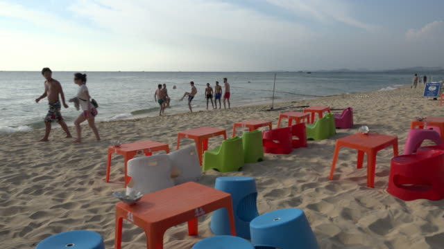 people on long beach at beach club - gulf of thailand stock videos & royalty-free footage