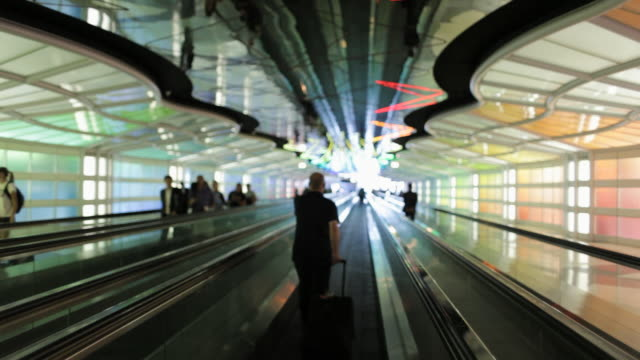ws pov people on moving walkway at  airport / chicago, illinois, united states - pedestrian walkway stock videos & royalty-free footage