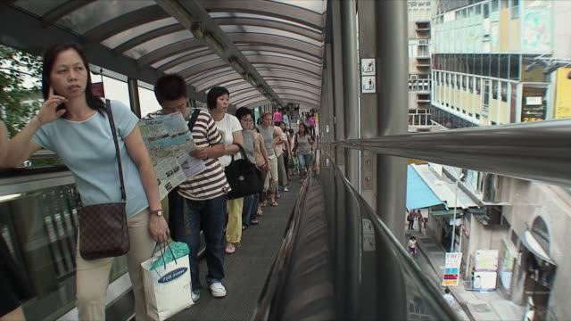 stockvideo's en b-roll-footage met ws ha rear pov people on moving walkway, hong kong, china - hong kong
