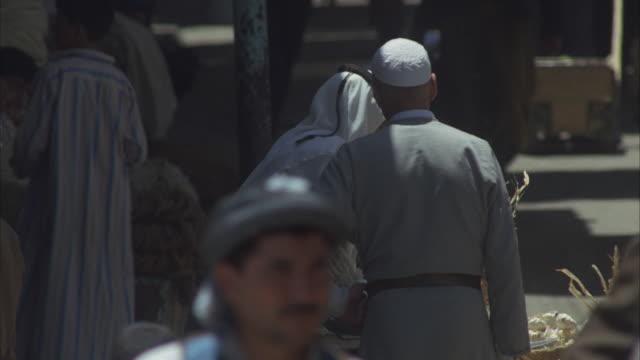cu, people on open market at narrow street, iraq - iraq stock videos & royalty-free footage