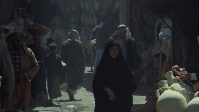 MS, People on open market at narrow street, Iraq