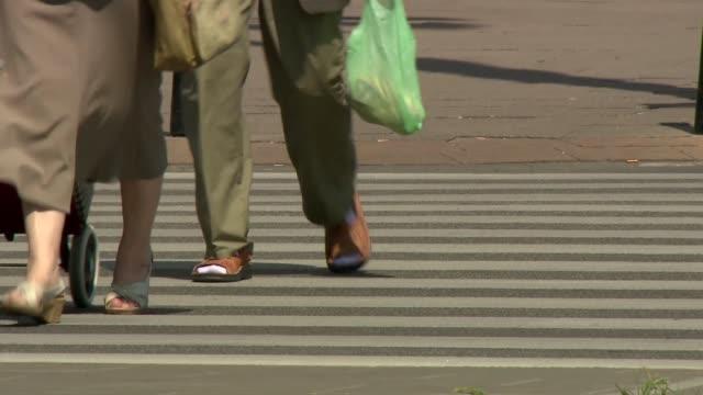 people on pedestrian crossing - sock stock videos & royalty-free footage