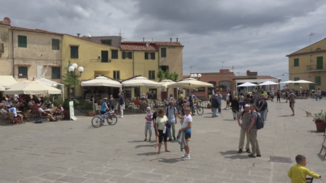 pan/ people on piazetta matteotti - village stock videos & royalty-free footage