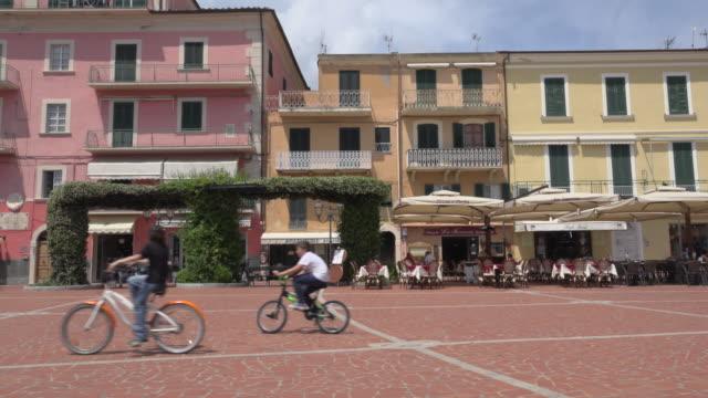 pan / people on piazza matteotti in porto azzurro - island of elba stock videos & royalty-free footage