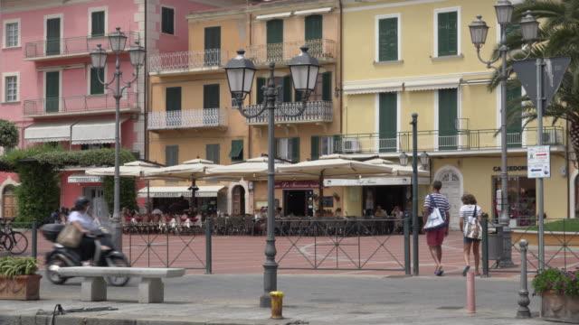 people on piazza matteotti in porto azzurro - island of elba stock videos & royalty-free footage