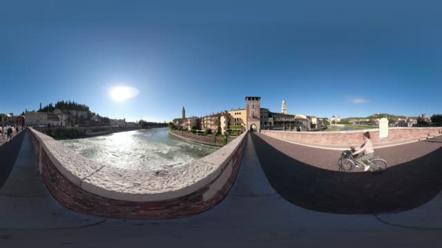 360 vr / people on ponte pietra over river adige, the entrance to verona - ponte stock videos & royalty-free footage