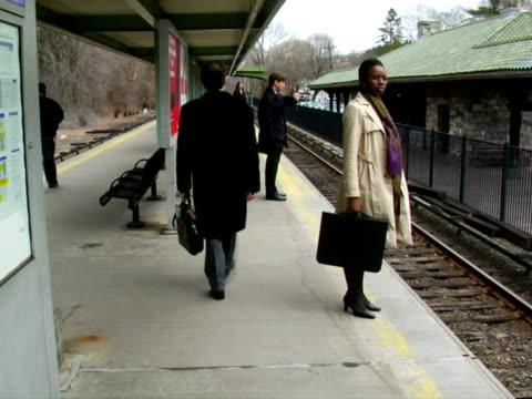 MS, People on railroad station platform, Chappaqua, New York State, USA