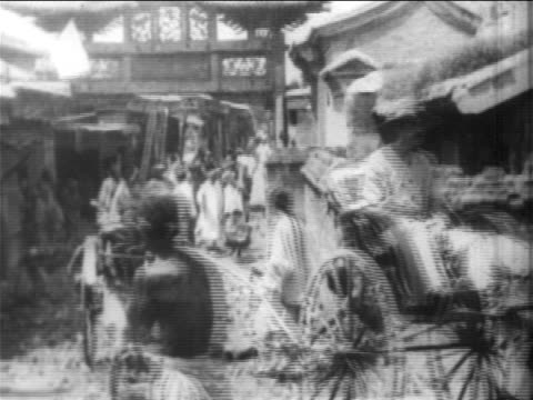 people on rickshaws + soldiers on peking street during boxer rebellion, china / newsreel - newsreel stock videos & royalty-free footage