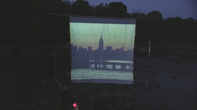 people on river watching movie screen - projection screen stock videos & royalty-free footage