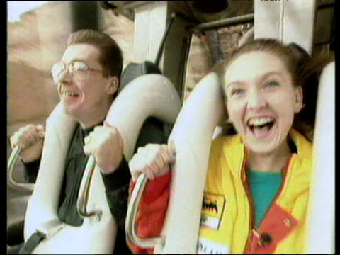 people on roller coaster ride alton towers - safety harness stock videos & royalty-free footage