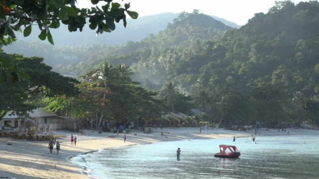 people on sandy beach in the evening - gulf of thailand stock videos & royalty-free footage