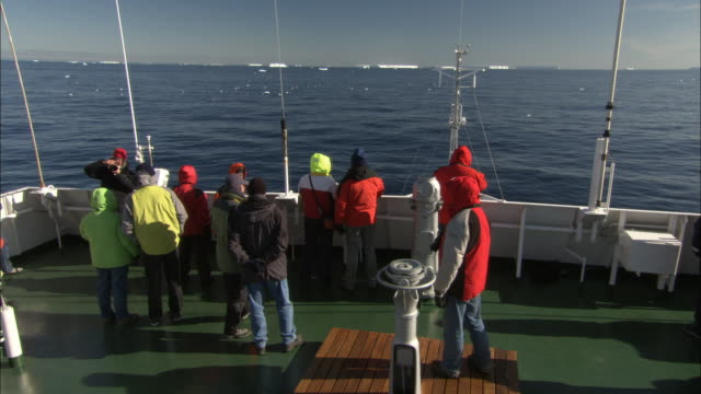 ms, ha, people on ship traveling through sea, tabular ice in distance, antarctica - climate research stock videos & royalty-free footage