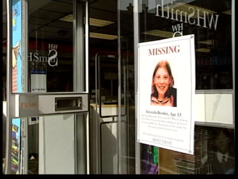 vidéos et rushes de people on shopping street missing poster on window of shop int amanda dowler's parents sally and bob dowler in press conference as bob comforts sally - affiche