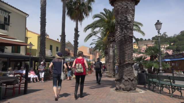 people on sidewalk in porto azzurro - island of elba stock videos & royalty-free footage