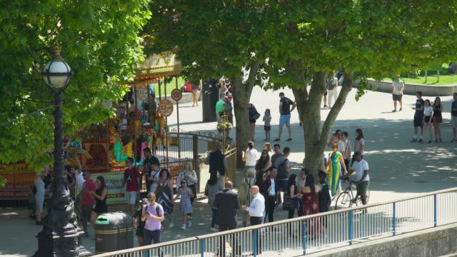ms people on south bank in london, uk - 屋外遊具点の映像素材/bロール