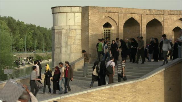 MS People on steps of Si-o-Se Pol Bridge (Allah-Verdi Khan Bridge), Isfahan, Iran