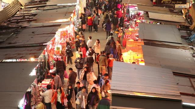 WS HA People on street market at dusk / Hong Kong, China