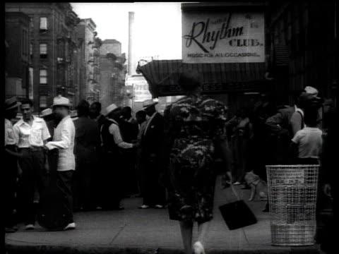 1939 ws people on street near rhythm cafe in harlem / new york city, usa - harlem stock videos & royalty-free footage