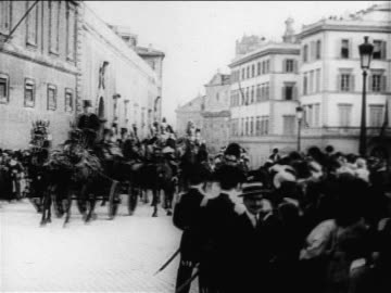 stockvideo's en b-roll-footage met people on street waving as royalty passes in carriages / europe / documentary - democratie