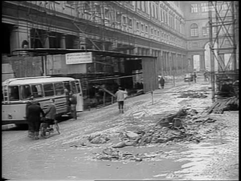 b/w 1966 people on street with rubble in front of building after flood / florence italy - anno 1966 video stock e b–roll