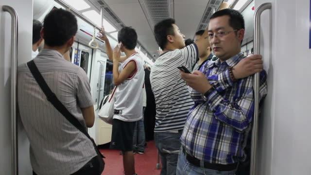 ws people on subway/xian,shaanxi,china - interno di treno video stock e b–roll