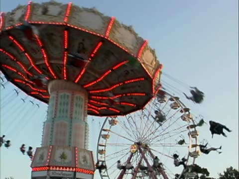 ws people on swing and ferris wheel  - agricultural fair stock videos and b-roll footage