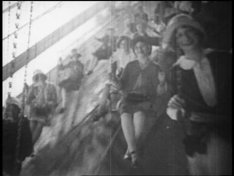 b/w 1928 people on swing ride at coney island / nyc / documentary - coney island stock-videos und b-roll-filmmaterial