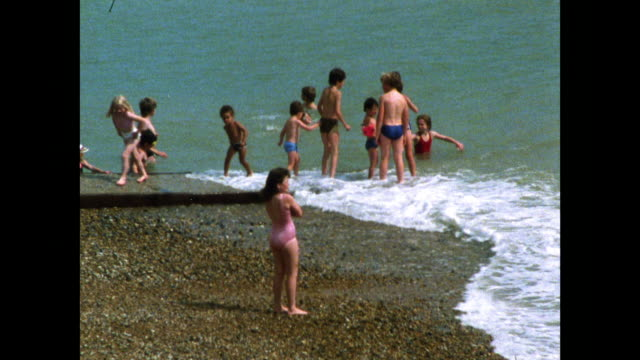 people on the beach and in the surf at hastings; 1986 - image stock videos & royalty-free footage