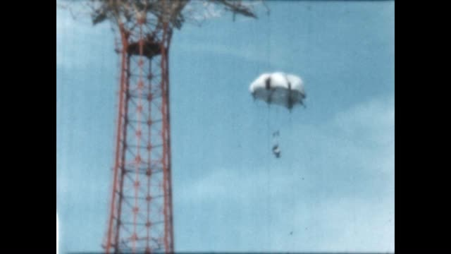 people on the beach at coney island beach / the life savers parachute jump from a home movie reel - coney island stock-videos und b-roll-filmmaterial