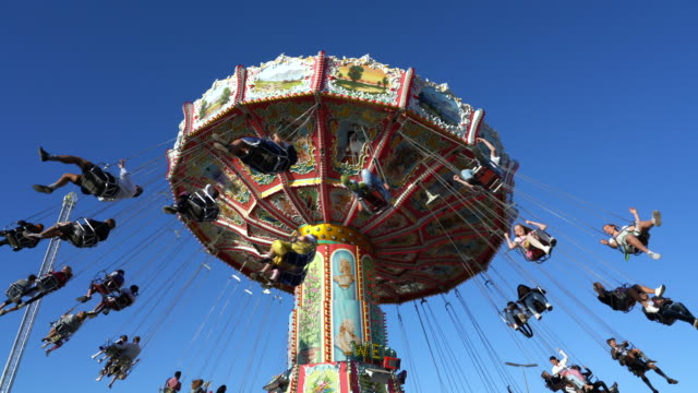 people on the chain carousel at oktoberfest, munich, germany - amusement park stock videos & royalty-free footage