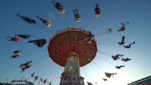 people on the chain carousel at oktoberfest, munich, germany - oktoberfest stock videos & royalty-free footage