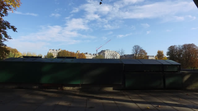 people on the pont neuf and quai de conti, with the booksellers closed, on the second day of isolation on october 31 in paris, france. france imposed... - ポンヌフ点の映像素材/bロール