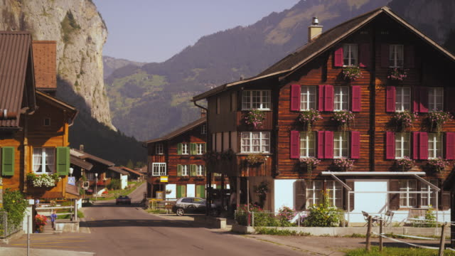 people on the street of small swiss village - chalet stock videos & royalty-free footage