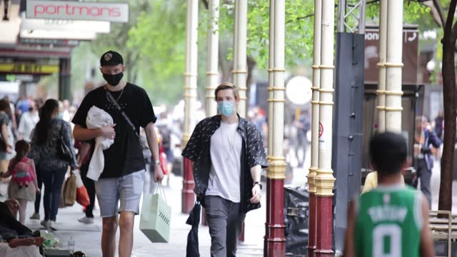 people on the streets of sydney wear face masks as nsw remains on high covid-19 alert on january 3, 2021 in sydney, australia. face masks are now... - australia stock videos & royalty-free footage