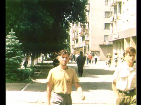 vídeos de stock e filmes b-roll de people on walking the streets of yampil town in sunny day - ucrânia
