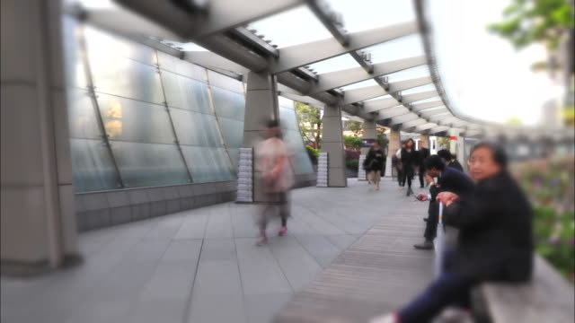 t/l ws people on walkway at roppongi hills, tokyo, japan - roppongi hills stock videos and b-roll footage
