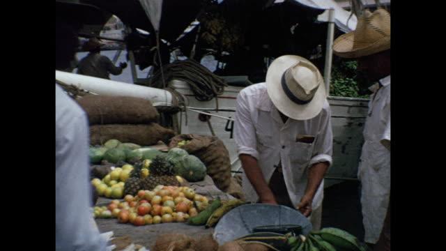 1954 home movie people on wharf, /  botica nueva, aruba, lesser antilles  - 1954 stock-videos und b-roll-filmmaterial