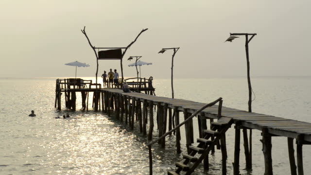 people on wooden jetty at sunset - gulf of thailand stock videos & royalty-free footage